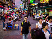 "24 JULY 2018 - BANGKOK, THAILAND:  on Khao San Road, in Bangkok. Khao San Road is Bangkok's original ""Backpacker Ghetto"" and is still a popular hub for travelers, with an active night market and many street food stalls. The Bangkok municipal government plans to shut down the street market by early August because city officials say the venders, who set up on sidewalks and public streets, pose a threat to public safety and could impede emergency vehicles. It's the latest in a series of night markets the city has closed.    PHOTO BY JACK KURTZ"