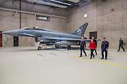 N&ouml;rvenich | Deutschland | 21.03.2016: Besuch vom BK Angela Merkel beim Taktischen Luftwaffengeschwader 31 Boelke auf dem Fliegerhorst in N&ouml;rvenich bei K&ouml;ln, das mit Kampfflugzeugen vom Typ Eurofighter Typhoon ausgestattet ist. Angela Merkel besichtig die Flugzeuge in einem Hangar und l&auml;uft sich von Soldaten die jeweiligen Systeme erkl&auml;ren.<br /> <br /> hier: Merkel mit Oberstleutnant Stefan Kleinheyer, Kommodore des Taktischen Luftwaffengeschwader 31 &bdquo;Boelcke&ldquo; (li) und dem Inspekteur der Luftwaffe, Generalleutnant Karl M&uuml;llner (2vr)<br /> <br /> 20160321<br /> <br /> <br /> [Inhaltsveraendernde Manipulation des Fotos nur nach ausdruecklicher Genehmigung des Fotografen. Vereinbarungen ueber Abtretung von Persoenlichkeitsrechten/Model Release der abgebildeten Person/Personen liegt/liegen nicht vor.] [No Model Release | No Property Release]