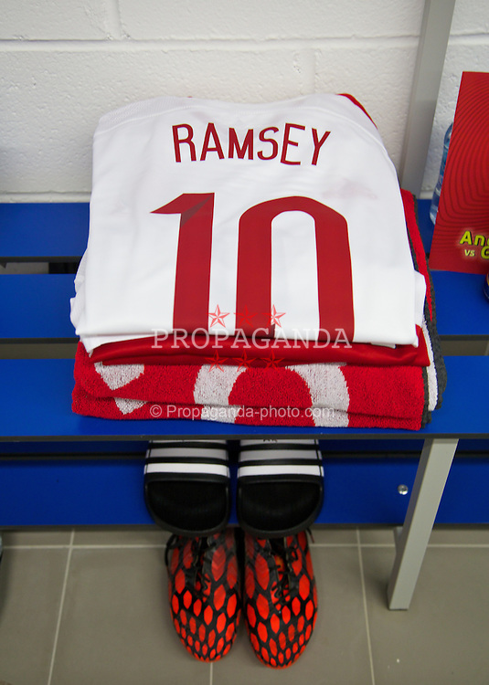 ANDORRA LA VELLA, ANDORRA - Tuesday, September 9, 2014: The Adidas shirt of Wales' Aaron Ramsey laid out in the dressing room before the opening UEFA Euro 2016 qualifying match against Andorra at the Camp d'Esports del M.I. Consell General. (Pic by David Rawcliffe/Propaganda)