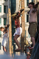Trafalgar Square, London, March 25th 2016. Thousands of Londoners an tourists in Trafalgar Square are treated to The Passion of Jesus, a re-enactment of the events leading up to the crucifixion and resurrection of Jesus Christ. PICTURED: Jesus on the cross between the two criminals. <br /> &copy;Paul Davey<br /> FOR LICENCING CONTACT: Paul Davey +44 (0) 7966 016 296 paul@pauldaveycreative.co.uk