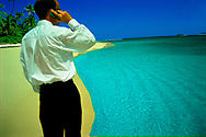 Man on phone in tropical destination.