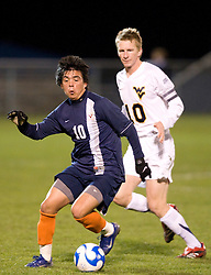 Virginia midfielder Jonathan Villanueva (10) dribbles past West Virginia midfielder Andy Wright (10).  The West Virginia Mountaineers defeated the Virginia Cavaliers 1-0 in the second round of the 2007 NCAA Men's Soccer Tournament at Dick Dlesk Stadium in Morgantown, WV on November 28, 2007.