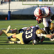 Smyrna running back William Knight (25) is tackled by Salesianum linebacker William Stradley (33) in the fourth quarter during a DIAA Division I championship game between Smyrna and Salesianum Saturday, Dec. 05, 2015 at Delaware Stadium in Newark.