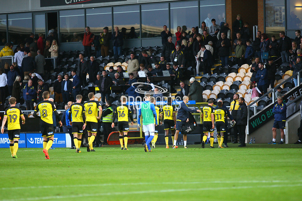 Burton Albion players make the walk back to the players tunnel after the final whistle during the EFL Sky Bet Championship match between Burton Albion and Ipswich Town at the Pirelli Stadium, Burton upon Trent, England on 28 October 2017. Photo by John Potts.