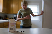 "New treatments have helped Emily Schaller, a 27-year-old cystic fibrosis patient, from Trenton, MI, recently run a half marathon. She takes 40 capsules of Pancrelipase each day to help digest nutrients from food. She also wears her ""smart vest,"" which shakes her chest to help break up mucous in her lungs and inhales from her nebulizer on Tuesday, April 21, 2009. She wears the vest for 25 minutes at least once every day. She inhales Pulmozyme for 7 minutes once and inhales hyper-tonic saline (salt water) twice every day."