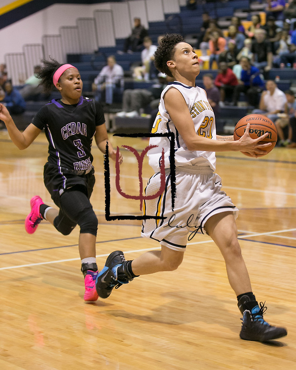 Stony Point's Chelsea Edwards makes a fast break to the basket against Cedar Ridge Friday.  The Tigers lost at home 75-37.  (LOURDES M SHOAF for Round Rock Leader.)