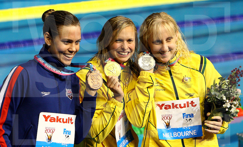 12th Fina World Swimming Championships Melbourne, 2007, 26th March, the womens 100m Butterfly Medal winners Gold, Libby Lenton, Aust Silver,Natalie coughlin,USA and Bronze, Jessica Shipper Aust..fotografie: frank uijlenbroek©2007Grant Treeby ..