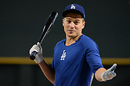 PHOENIX, AZ - AUGUST 10:  Enrique Hernandez #14 of the Los Angeles Dodgers reacts during batting practice for the MLB game against the Arizona Diamondbacks at Chase Field on August 10, 2017 in Phoenix, Arizona.  (Photo by Jennifer Stewart/Getty Images)
