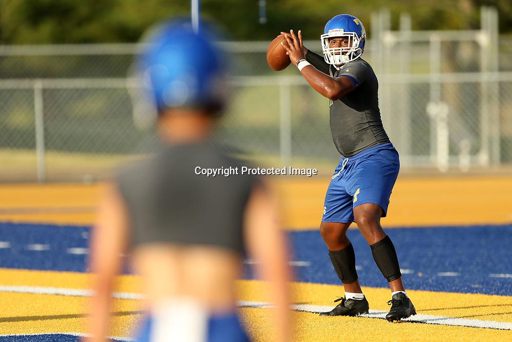 Tupelo quarterback, Stephon McGlaun, goes through a series of throwing drills during Monday nights practice at Tupelo High School.