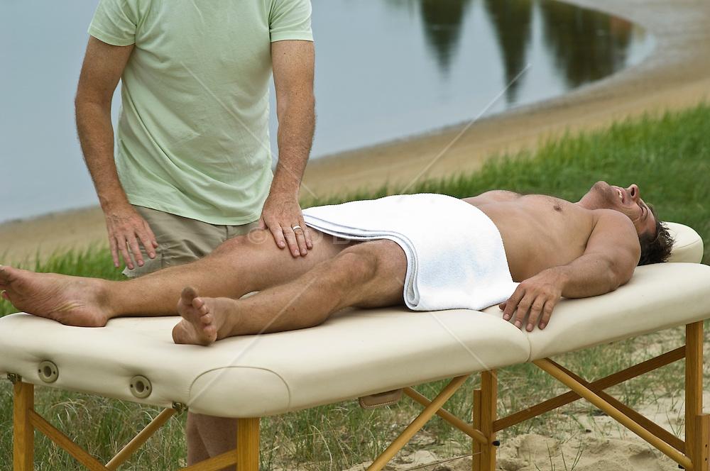 Man enjoying a massage outside in  East Hampton, NY