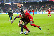 Liverpool forward Sadio Mané (10) is challenged by Red Bull Salzburg defender Rasmus Kristensen (43) during the Champions League match between FC Red Bull Salzburg and Liverpool at the Red Bull Arena, Salzburg, Austria on 10 December 2019.