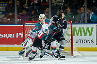 KELOWNA, CANADA - FEBRUARY 16:  Jared Dmytriw #22 of the Vancouver Giantsj looks for the pass behind Kyle Crosbie #25 of the Kelowna Rockets during first period on February 16, 2019 at Prospera Place in Kelowna, British Columbia, Canada.  (Photo by Marissa Baecker/Shoot the Breeze)
