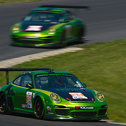 July 6, 2012 - The Green Hornet Racing Porsche 911 GT3 Cup cars driven by Peter LeSaffre and Damien Faulkner (near) and LeSaffre and Anthony Lazzaro (far) practice for the American Le Mans Northeast Grand Prix weekend at Lime Rock Park in Lakeville, Conn.