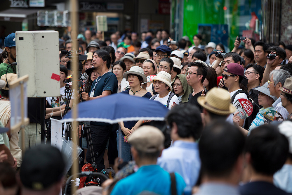 TOKYO, JAPAN - JULY 8 :  Supporters watch the campaign speech of candidate Yohei Miyake for July's House of Councillors elections outside Ikebukuro Station, Tokyo, Japan, on July 8, 2016. The July 10, 2016 Upper house election is the first nation-wide election in Japan after government law changes its voting age from 20 years old to 18 years old. (Photo by Richard Atrero de Guzman/NUR Photo)