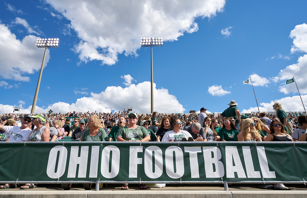 The Crowd at Peden Stadium intently watches kickoff.