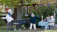 It was a glorious day for a BBQ for the scarecrow family located at the Snow's home being one of the scarecrow contest entries for Gilford's 4th annual Heritage Festival Saturday.   (Karen Bobotas/for the Laconia Daily Sun)