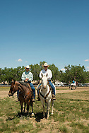 Jay Shaw, Pickup man at 2012 Miles City Bucking Horse Sale, joined by his father retired great Kyle Shaw, Montana