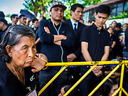 27 SEPTEMBER 2017 - BANGKOK, THAILAND:  Thais wait in line to pay respects to the late king. They were about a mile from the Grand Palace at this point. The Royal Household has announced that the palace will close to the public, including tourists, on 04 October 2017 to allow officials to complete preparations for the cremation of Bhumibol Adulyadej, the King of Thailand, who died on 13 October 2016. They also extended the official mourning period by 15 days. It was originally set to end on 13 October 2017 but now will end on 26 October 2017, the day of the King's cremation.    PHOTO BY JACK KURTZ