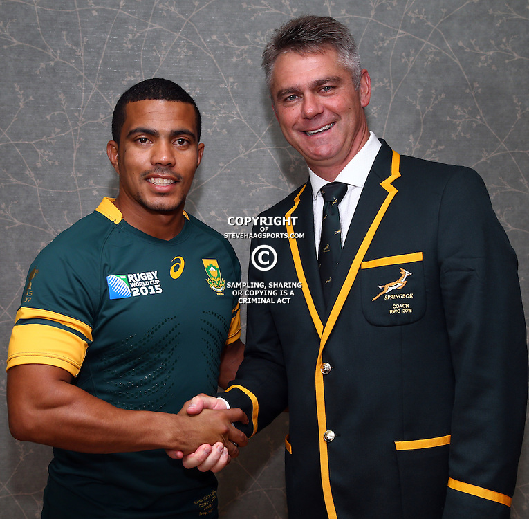 LONDON, ENGLAND - OCTOBER 06: Rudy Paige with Heyneke Meyer (Head Coach) of South Africa during the South African national rugby team Official Team Photograph at The Lensbury Hotel on October 06, 2015 in London, England. (Photo by Steve Haag/Gallo Images)