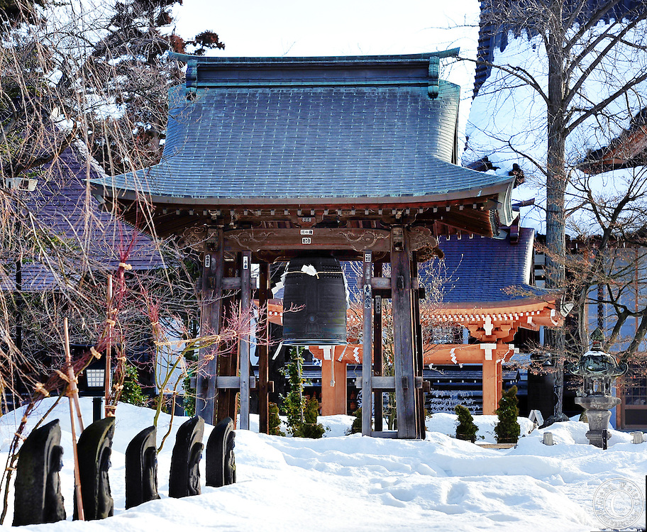 Gojunoto Temple in Hirosaki northern Japan.The Buddhist statues are half covered with snow.