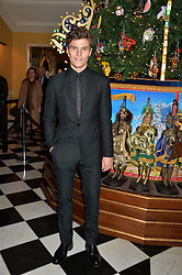 OLIVER CHESHIRE at the Claridge's Christmas Tree By Dolce & Gabbana Launch Party held at Claridge's, Brook Street, London on 26th November 2013.