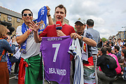 Tv reporter with Real Madrid fans and Ronaldo shirt before the Champions League Final between Juventus and Real Madrid at the National Stadium of Wales, Cardiff, Wales on 3 June 2017. Photo by Phil Duncan.
