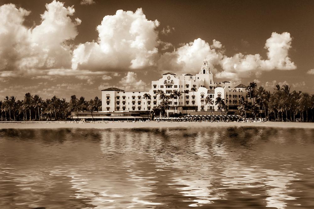 Photo art image of reflections of the Royal Hawaiian hotel on Waikiki Beach in Hawaii