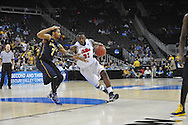 Ole Miss' Murphy Holloway (31) drives gainst La Salle's Tyreek Duren (3) in the Round of 32 of the NCAA Tournament at the Sprint Center in Kansas City, Mo. on Sunday, March 24, 2013. La Salle won 76-74.