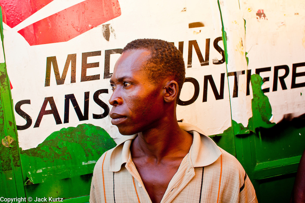 18 NOVEMBER 2010 - PORT-AU-PRINCE, HAITI: People wait to get into a Medicins Sans Frontieres (MSF - Doctors Without Borders) cholera stabilization center in Cite Soliel in Port-au-Prince. Cite Soleil, a sprawling slum area in PAP is ground zero for the cholera epidemic in the Haitian capital. An outbreak of cholera in northern Haiti about a month ago has spread across the nation. Tens of thousands of people have been hospitalized and treated for cholera and more than 1,100 have died. Cholera is a water borne illness that causes severe diarrhea and death by dehydration in a matter of hours.   PHOTO BY JACK KURTZ  choleraepidemic