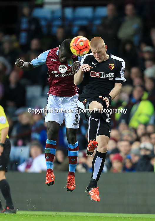 28th November 2015 - Barclays Premier League - Aston Villa v Watford - Idrissa Gueye of Aston Villa and Ben Watson of Watford battle for a high ball - Photo: Paul Roberts / Offside.