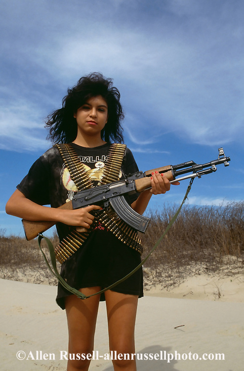 Hispanic woman with AK47 Assault Rifle, South Texas,<br />