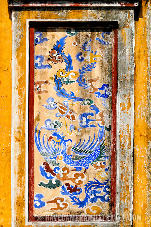 Detail of some of the artwork adorning the Dien Tho Residence gate at the Imperial City in Hue, Vietnam. A self-enclosed and fortified palace, the complex includes the Purple Forbidden City, which was the inner sanctum of the imperial household, as well as temples, courtyards, gardens, and other buildings. Much of the Imperial City was damaged or destroyed during the Vietnam War. It is now designated as a UNESCO World Heritage site.