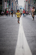 Boy running on the streets of Ginza (Tokyo, Japan)
