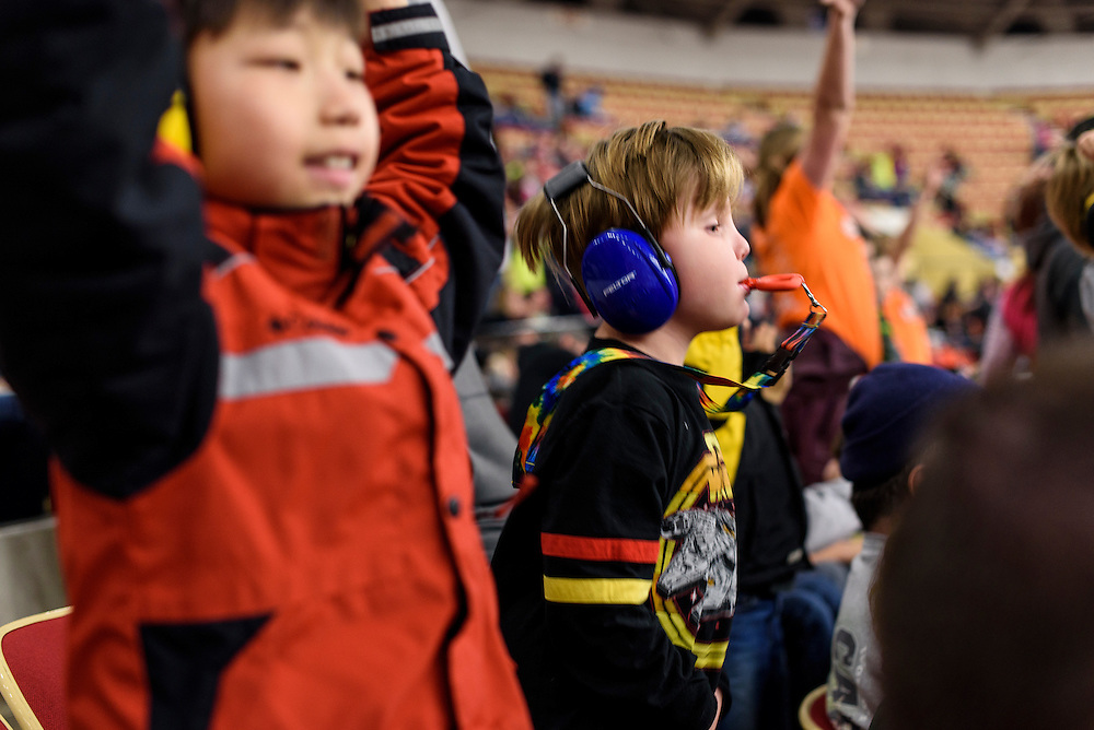 Holden Miller, 8, and Wilder Johnson are amid the cheering fans watching the Monster Truck Nationals at the Veterans Memorial Coliseum at the Alliant Energy Center in Madison, Wis., on Jan. 31, 2016. (Photo by Jeff Miller, www.jeffmillerphotography.com)