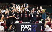 Stanford Cardinal holds up the Pac-12 trophy after beating Oregon in the championship game of the Pac-12 Conference women's basketball tournament Sunday, Mar. 10, 2019 in Las Vegas.  Stanford defeated Oregon 64-57. (Gerome Wright/Image of Sport)