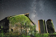 The not so distant past is seen through an old barn holding steadfast under the weight of nature, while the stars behind paint a picture of a much more distant past.