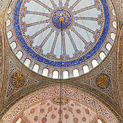 The ornately decorated dome and ceiling of the Blue Mosque. Hundreds of wires support the lighting system. Sultan Ahmed Mosque (Turkish: Sultanahmet Camii) known popularly as the Blue Mosque is a Muslim (Sunni) Mosque in the center of Istanbul's old town district of Sultanahmet. It was commissioned by Sultan Ahmed I and completed in 1616,