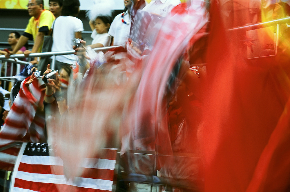 Paralympics Day 9 - Beijing 2008<br /> Supporters with flag of USA during the final of women's wheelchair basketball<br /> Supporters are waving american and chinese flags during the final of Women's wheelchair basketball , between USA and Germany in the National Indoor Stadium. American athletes will take the gold medal by 50 vs 38. Paralympic Games, Beijing , September 15 2008