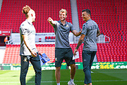 Leeds United forward Patrick Bamford (9) and Leeds United defender Ben White (5) arrive at the ground during the EFL Sky Bet Championship match between Stoke City and Leeds United at the Bet365 Stadium, Stoke-on-Trent, England on 24 August 2019.