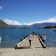 A boat pier on the edge of Lake Wanaka.  Wanaka is  a year round destination set against the pristine alpine backdrop of Mount Aspiring National Park in Central Otago. South Island, New Zealand. 1st April 2011. Photo Tim Clayton.