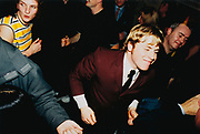 A Mod in a suit, dancing at a club, Cardiff, Wales, 2000's