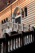 Detail of staircase, Palazzo del Comune, or della Ragione, c.1193, restored many times, between Piazza dei Signori and Piazza delle Erbe, Verona, Italy.  The Palazzo dei Comune is the oldest city hall in Italy although damage from three fires. Its double ramp of steps is embellished with decorative scupltures. Picture by Manuel Cohen.