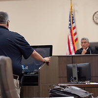 Grants Police Chief Steve Chavez, at the podium, gives his  remarks during the sentencing of Deborah Green at the Thirteenth Judicial District Court Wednesday afternoon in Grants.