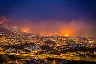 View of a forest fire in Funchal, Madeira Island, Portugal, 09 August 2016. The fire has led to the evacuation of 400 people. Portugal remains on high alert as a wave of wildfires has swept the country with around 350 isolated fires affecting swathes of the countryside. EPA/GREGÓRIO CUNHA