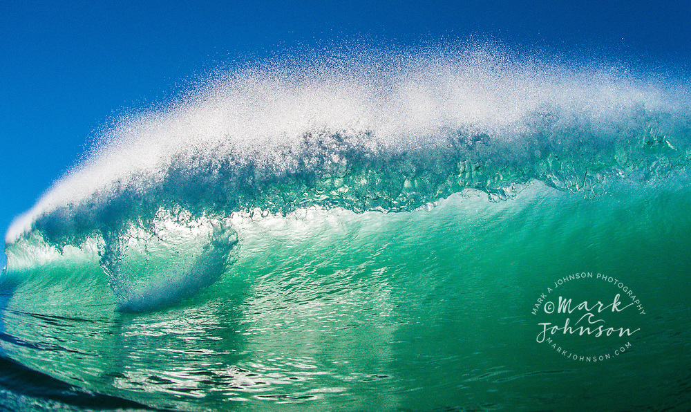 Breaking wave off South Stradbroke Island, Gold Coast, Queensland, Australia