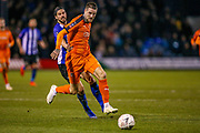 Sheffield Wednesday midfielder George Boyd (21) tries to hold back Luton Town defender Sonny Bradley (5) during the The FA Cup 3rd round replay match between Luton Town and Sheffield Wednesday at Kenilworth Road, Luton, England on 15 January 2019.