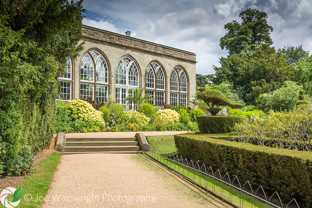 This conservatory, at Warwick Castle, was built in 1786.  Peacocks roam free in the gardens around, which also feature topiary versions of the birds.