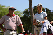 Fifteen year old Michelle Wie stares down the fairway with her caddy before a tee shot during a practice round prior to The 2005 Sony Open In Hawaii. The event was held at The Waialae Country Club in Honolulu.