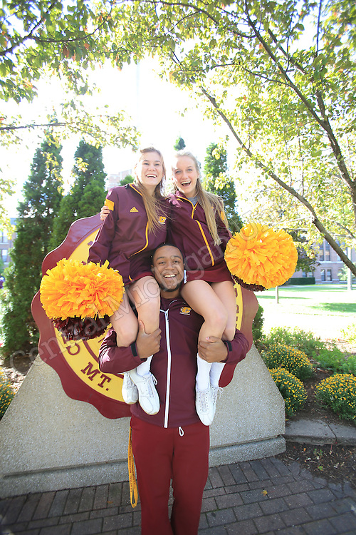 Aaron Martin-Green,  (top left)  McKenzie Fuller, (top right) Faith Ann Marie Nesbitt at Central Michigan University. <br /> <br /> Cheerleaders delivered energetic cheers, free T-shirts rained from cannons and the pep band&rsquo;s instruments blared at popular locations across campus Friday morning as part of Fire Up Friday. Even head football coach John Bonamego joined in on the homecoming festivities, shooting T-shirts to students in Warriner Mall.  Photos by Steve Jessmore/Central Michigan University