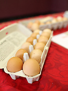 Free range eggs for sale at the Bloomin' Prairie Chickens booth during the Indoor Winter Farmers Market at the First Street Community Center at 221 First Street NE in Mount Vernon on Saturday, April 16, 2011.